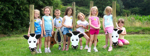 "Group playing ""lasso the cow"""